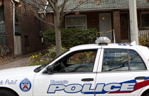 Police officers from 55 Division investigated after finding the body of a woman in a home on Ladykirk Avenue. Police were called to the residence on Nov. 14. PHOTO: Phil Lameira / Beach Metro News
