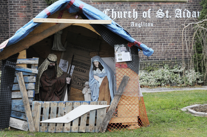 The nativity scene at St. Aidan's is currently housed in a scrap material shack. As donations to the church youth group's upcoming mission trip are raised, the shack will be upgraded; the idea mimics plans to upgrade housing for the poor in Nicaragua. PHOTO: Jon Muldoon