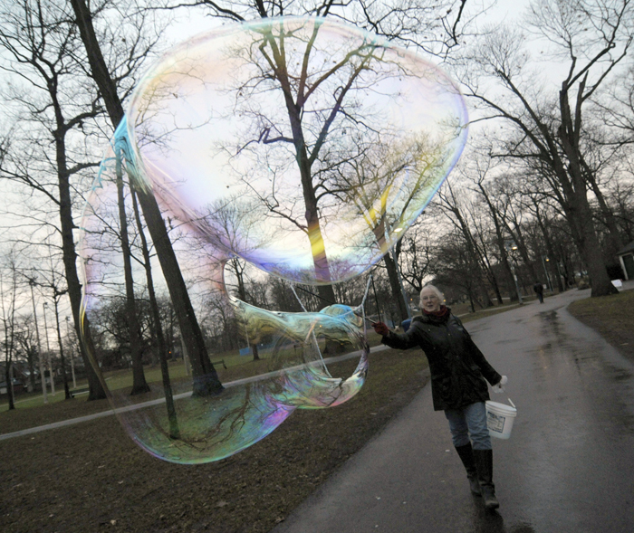 Mairead Lavery adds a little magic to Kew Gardens with a special mixture that helps her create giant, iridescent bubbles. PHOTO: Jon Muldoon / Beach Metro News