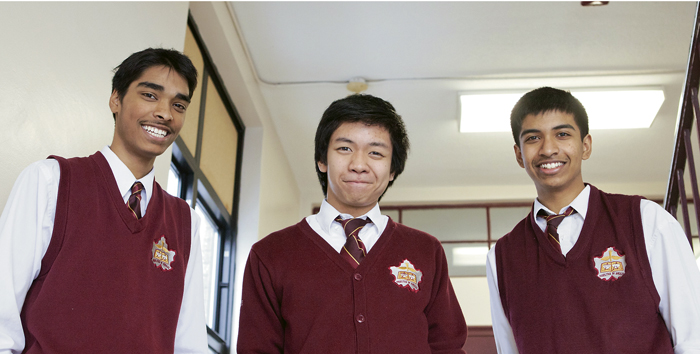 Neil McNeil Grade 11 students Tamim Chowdhury, left, Enrique Olivo, centre, and Gowttam Perinpanayagam placed fourth in a student business competition. PHOTO: Phil Lameira / Beach Metro News