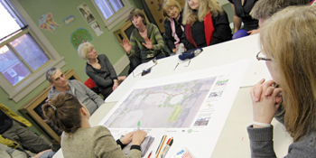 Landscape architect Netami Stuart discusses a draft plan with the Friends of Stephenson Park and Mary-Margaret McMahon on April 2 at Community Centre 55.
