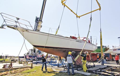 A crane crew at the Ashbridges Bay Yacht Club harness the Sakara for launch.