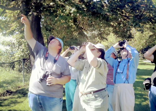 Big Frank, right, points out a bald eagle flying above Rosetta McLain Gardens in the fall of 2012 next to Theresa and his mentor and good friend Colin, right. PHOTO: Phil Lameira