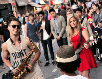 Rob Christian, left, digs a riff by bandleader Quincy Bullen, centre, while Saya Gray plays bass at the 2013 Beaches International Jazz Festival Streetfest. PHOTO: Andrew Hudson