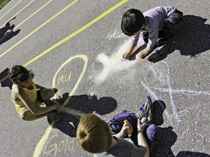 Duke of Connaught students chalk a yellow ribbon and other messages of hope to mark Childhood Cancer Awareness Month on Sept. 27. PHOTO: Andrew Hudson