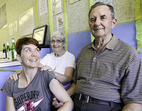 From left, Michelle, Cathy and Mike Burca celebrate Mike's retirement from the Coxwell Coin Laundry at Dundas Street and Coxwell Avenue. PHOTO: Andrew Hudson
