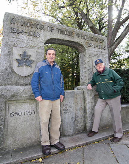 Veteran Jimmy Canning, right, and Beach Metro history columnist Gene Domagala stand by the Kew Gardens war memorial. PHOTO: Andrew Hudson