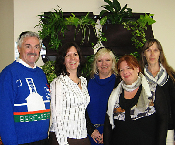 """From left, Beaches-East York MPP Michael Prue, Beach Business Hub owner Martina Rowley, Gail Kendall, Deborah Miller and Deborah Jones were on hand for the Beach Business Hub's recent first anniversary open house. Past and regular networkers (""""hubsters,"""" according to Rowley) were joined by dignitaries and those curious about the facility and its services, located at 2181 Queen St. E., at Lee Avenue. Unveiled at the open house was the new living wall, seen above, one of the many improvement implemented over the past months. For more on the Hub, visit beachbusinesshub.ca."""