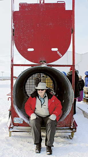 Catherine Hastie is seen in a polar bear trap during a trip to Churchill, Manitoba.