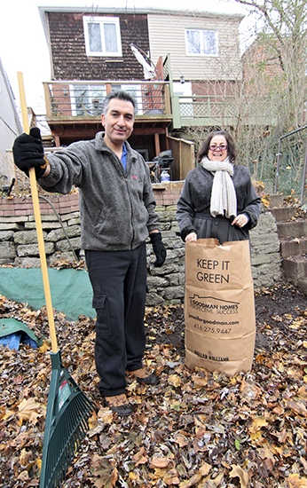 Hamid Ghassemi-Shall and Antonella Mega rake leaves outside their Beach home on Nov. 30. Hamid returned to Toronto on Oct. 10, more than five years after he was wrongfully imprisoned in Iran while visiting family. PHOTO: Andrew Hudson