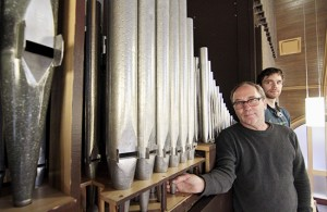 Robert Hiller, left, Toronto representative for the Casavant Freres organ builders, and apprentice Sasha Achtemichuk stand by the Guilbault-Thérien organ that was moved from Bellefair United to the new Beach United Church. Originally built in 1928 by Franklin-Legge, a Toronto company, the organ was substantially rebuilt in 1991 by Guilbault-Thérien at a cost of $250,000. PHOTO: Andrew Hudson
