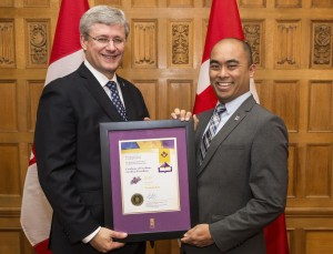 Vernon Kee, right, receives his Excellence in Teaching Award from Prime Minister Stephen Harper. PHOTO: Submitted