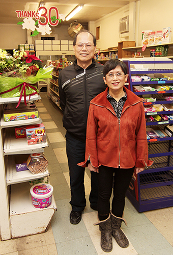Guang Yuh and Yen Man Chern stand in Harry's Variety just before it closed at Christmas after thirty years. PHOTO: Andrew Hudson