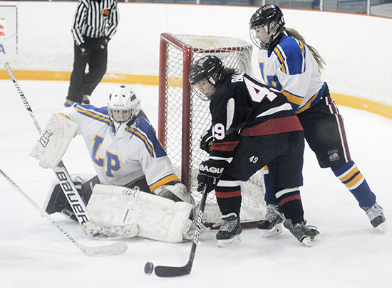 Malvern's Molly Balaszi shoots on Lawrence Park goalie Samie Gorman in TDSSAA Tier 1 girls hockey action at Ted Reeve Arena on Jan. 15. Lawrence Park won the game 7-3. PHOTO: Jon Muldoon