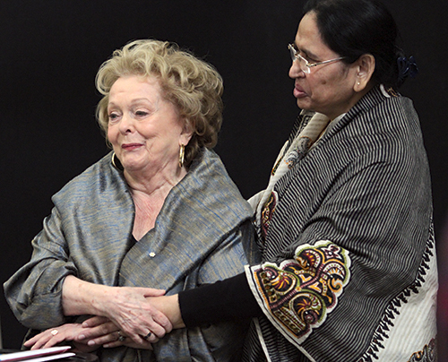 Actress, activist and public health care advocate Shirley Douglas thanks Sufia Shahid, president of Shwasti, a grassroots women's empowerment group based in Crescent Town, before giving the keynote speech for International Women's Day at AccessPoint on Danforth on March 8. Known to many for her role as the tough, Depression-era businesswoman May Bailey in CBC's Wind At My Back, Douglas spoke about her long history of organizing women for social causes, her years as a mother in Crescent Town, and the lessons she learned from her mother Irma and her father Tommy Douglas, the late NDP premier of Saskatchewan who is widely recognized as the founder of medicare in Canada. PHOTO: Andrew Hudson