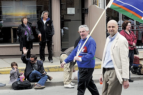 MPP Michael Prue, left, with his Beach flag, and MP Matthew Kellway, right, are seen in the 2012 Beaches Lions Easter Parade. Both have been told elected representatives are not welcome to march in the 2014 parade. PHOTO: Beach Metro News