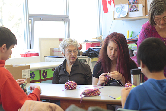 Jenny Harper guides Rachel, a Grade 8 student at Duke of Connaught, as she and her classmates learn to knit cotton-yarn dishcloths at a Colour Crafters workshop on March 18. A joint effort by Duke of Connaught Public School and Applegrove Community Complex, which share a building, the workshops bring students and seniors together to learn crafts such as painting, woodcarving, book making, and pressed flower art. PHOTO: Andrew Hudson