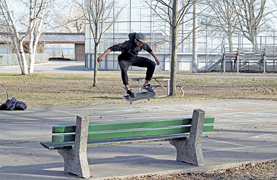 Skateboarder Harrison Robinson ollies in Kew Gardens on April 24. It was a sunny, 13°C day that seemed to jump a whole season ahead from the wintry scene on April 15.  PHOTOS: Andrew Hudson