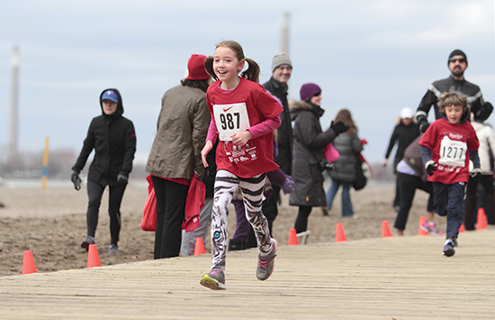 Sofia Higgins, right, sprints like a tiger to finish the 2 km children's race at the 27th annual Spring Sprint. PHOTOS: Andrew Hudson