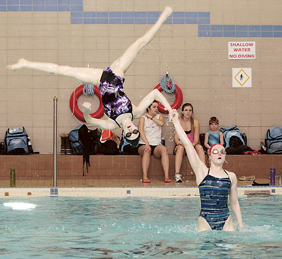 Members of Variety Village Synchro Club's Tigers team work on their aerial moves at a recent club practice. PHOTO: Andrew Hudson