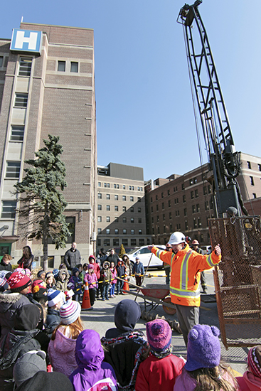 AMEC engineer Michael Salter talks to Grade 1 and 2 students from nearby RH McGregor Public School on April 16 about the test drilling underway at the future site of Toronto East General's new patient tower. PHOTO: Andrew Hudson