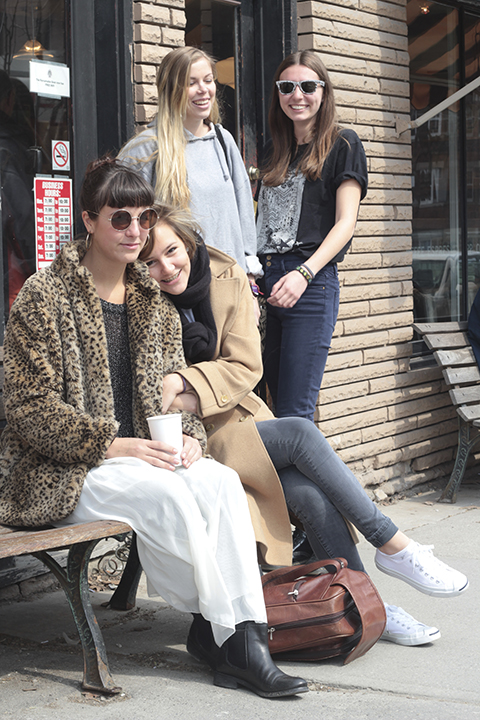 From left, The Beaches' Jordan Miller, Kylie Miller, Eliza Enman-McDaniel and Leandra Earl take a break on Queen Street. The local indie rockers release their second EP, Heights, on May 5. PHOTO: Andrew Hudson