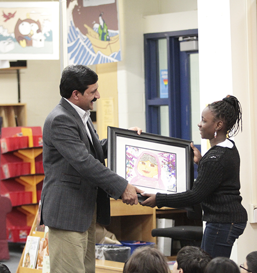 Ziauddin Yousafzai receives a painting as a thank-you from Secord Elementary School. PHOTO: Andrew Hudson
