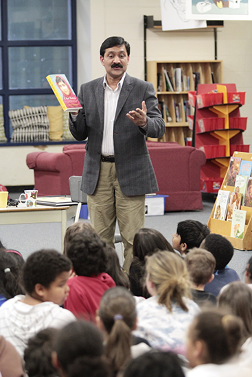 "Ziauddin Yousafzai, father of Pakistani blogger and girls' rights activist Malala Yousafzai, speaks to Grade 4 and 5 students at Secord Elementary School on March 29.  Along with Plan Canada president Rosemary McCarney, a Beacher who wrote a recently published picture book called Every Day is Malala Day, Ziauddin spoke about the rights of all girls and boys to go to school, free from forced labour and the kind of misogynist violence his daughter survived.  Before he let the students get back to class, Ziauddin, a long-time teacher, asked them to recite a line by the poet Khalil Gibran: ""Keep me away from the greatness that does not bow to children."" PHOTO: Andrew Hudson"