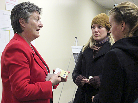 Ward 31 councillor Janet Davis, left, speaks with East End residents Meg De Bassecourt, centre, and Orla Kipling at a recent open house dealing with construction planned for Danforth Avenue between Woodbine and Victoria Park. PHOTO: Yasmin Soul
