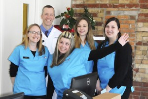 From left, Karen, Rob, Sheena, Jaclyn and Alexandra are ready for furry business at the newly-opened Main Street Veterinary Clinic.
