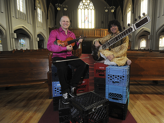 Chris McKhool, left, of the Sultans of String, and Anwar Khurshid will perform at Kingston Road United Church on May 4. The show will raise funds for the church, including accessibility upgrades and, if McKhool has any say, for a new stage, as the current stage is built on a base of milk crates. PHOTO: Jon Muldoon