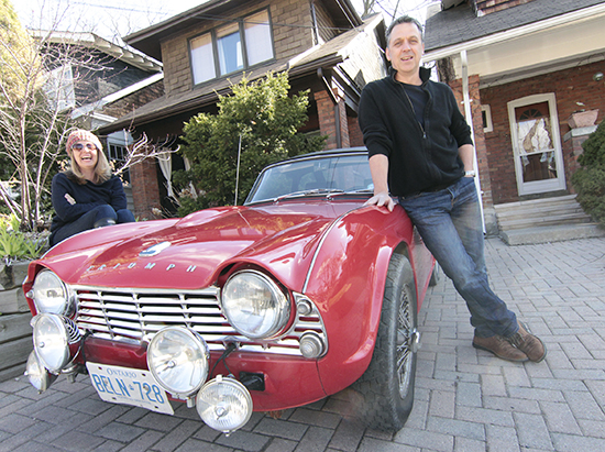 "Tim Burgess and Jan Frolic pose for a ""before"" shot with their 1961 Triumph TR4 sports car, which they will drive some 7,200 km this August on a nine-day rally from Seattle to Alaska. Along the way, the Beach couple hopes to raise $5,000 for Princess Margaret Hospital. Anyone who wants to make a donation or track their progress on rally can find out more on the Facebook page called Jan & Tim's Excellent Adventure. PHOTO: Andrew Hudson"