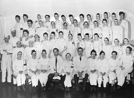 Mary Franklin poses with colleagues at the Pickering munitions plant in the 1940s. Franklin is standing in the third row from the front, fifth from the right. At its peak, the war-time munitions plant employed some 9,000 people, who came from all over Canada. PHOTO: Submitted