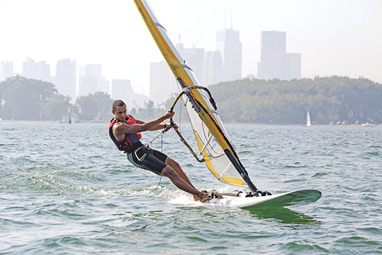 Max Robinson windsurfs off Cherry Beach while training at the Toronto Windsurfing Club last year. The 21 year-old Beach resident has competed in several international regattas on the Olympic-class RS:X, and is campaigning for a spot at the 2015 Pan Am and 2016 Olympic Games. PHOTO: Toronto Windsurfing Club