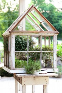 An example of a small greenhouse built from reclaimed windows. PHOTO: erin-artandgardens.blogspot.com