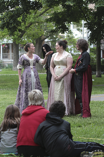 Desdemona (played by Melissa Beveridge, left) and Bianca (Andrea Cabeza, centre) share a laugh at Iago (James Soares, right) while Roderigo (Jonathan Dufour) looks on with a sinister grin during the June 11 opening of Bard in the Park's Othello at Norwood Park. PHOTO: Andrew Hudson