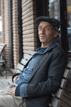 Cartoonist, song writer, and keen-eyed Toronto observer Carmin Priolo relaxes outside a coffee shop on Queen Street East. PHOTO: Andrew Hudson