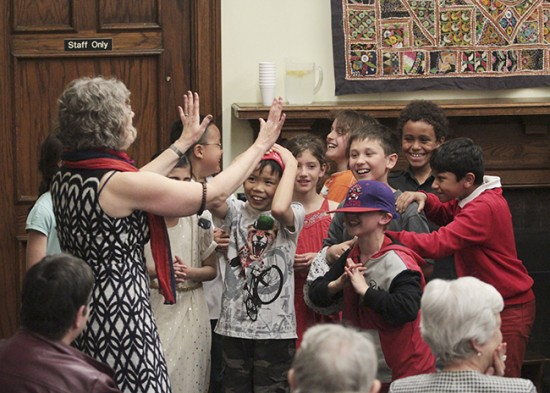 A choir from Roden Public School shares a laugh with librarian Gail Ferguson after singing Pennies from Heaven for a 90th anniversary celebration at the Gerrard Ashdale Library on May 15. PHOTO: Andrew Hudson
