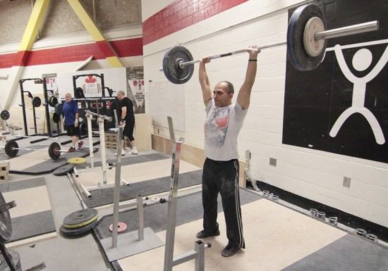 Eric Savva, right, completes a training lift while Raymond St. Jean, left, and Iain Douglas step up to their own weights at Variety Village on May 31. Savva, St. Jean, and Mylène Bourget, all members of Variety's weightlifting club, will compete in the Pan Am Master weightlifting championships on June 20 and 22. PHOTO: Andrew Hudson