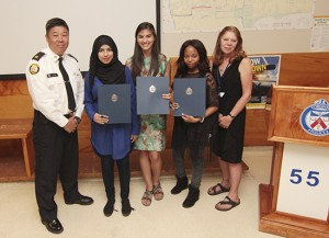 From left, Superintendent Peter Yuen stands with local high school graduates Emman Haider, Kendall Mar, Ruth Kayembe, and Community Centre 55's Nancy Culver on June 19 after the students were awarded scholarships from 55 Division's Community Police Liason Committee. PHOTO: Andrew Hudson
