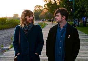 Zoe Kazan and Daniel Radcliffe go for a stroll on the Boardwalk in a scene from The F Word.