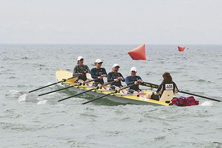 Rowers from the Club d'Aviron in Alma, Quebec, compete in a coastal-style, or open-water regatta at Balmy Beach on August 16. Hosted by Hanlan Boat Club, the regatta drew 45 rowers from three clubs and was the first sanctioned event of its kind in Ontario. PHOTO: Andrew Hudson