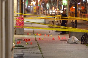Police investigate at the scene of a homicide on Danforth Avenue near Dawes Road. Two people were stabbed, one fatally, on Monday just after 5 p.m. PHOTO: Phil Lameira