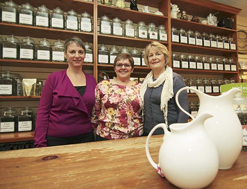 "From left, Nancy Jones, Barb DeAngelis and Julie Clark of Pippins Tea drop their party preparations for a quick photo before Pippins celebrated its 10th anniversary on Saturday, Sept. 19. DeAngelis said she worked at the Sears head office for 25 years before she quit to open the tea shop. ""You know how you say, 'I can't wait for Friday?'"" she said. ""For 10 years I've never had that feeling. Never ever!"" PHOTO: Andrew Hudson"