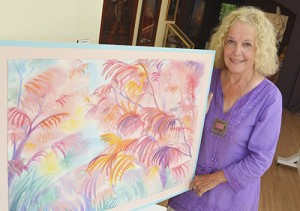 Painter and one of the founding members of the Beach Guild of Fine Art Jennifer Cline shows one of the paintings that will be available at the Guild's Art in the Beach show. PHOTO: Jon Muldoon