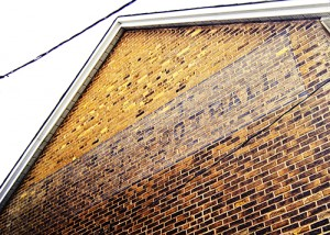 This faded sign for Prest's sporting equipment is more than 100 years old and may be the oldest in the area. PHOTO: Andrew Hudson