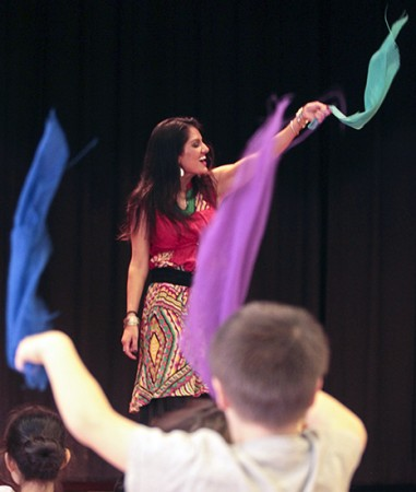 Dancer Krystal Kiran of Cornerstone Studio leads Bowmore students in a Bollywood-style dance at the Bowmore Multicultural Potluck on Nov. 20. PHOTO: Andrew Hudson
