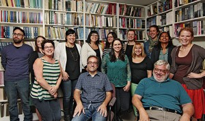 Co-publishers Jack David, front right, and David Caron, front left, gather with ECW Press staff in the local publisher's in-house library. ECW recently celebrated 40 years in Canadian publishing, as well as the selection of two of its authors for the Giller Prize long list.  PHOTO: Andrew Hudson