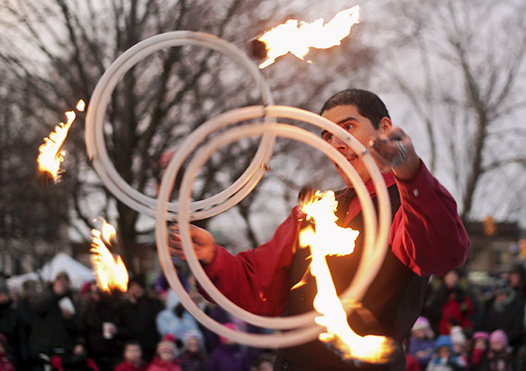 'The Pyroneer' from Zero Gravity Circus performs at the DECA Festival of Lights on Nov. 29, 2014. PHOTO: Andrew Hudson
