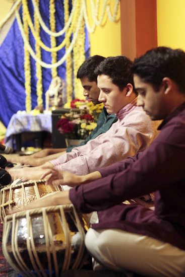 Razak Pirani, Aaron Fernandez, and Shamir Panchal, performing members and teachers of the Toronto Tabla Ensemble, play during the ensemble's studio opening on Jan. 24.